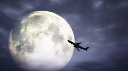 fullmoon : Full Moon behind intensively moving clouds and an airplane flying in the Moon aura at a spooky night 3D Animation