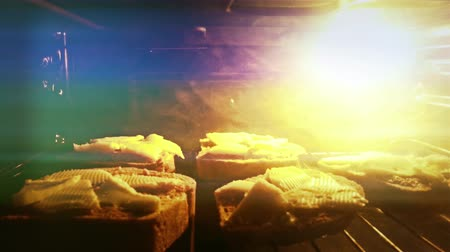 хлеб : 4K Tasty Homemade Hot Sandwiches with Melted Cheese are being baked in the oven Стоковые видеозаписи