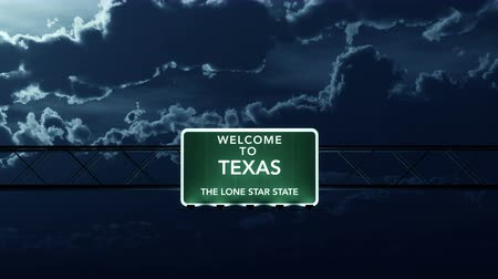 teksas : 4K Passing under Texas USA Interstate Highway Road Sign at Night Photo Realistic 3D Animation with Matte 4K 4096x2304 ultra high definition Stok Video