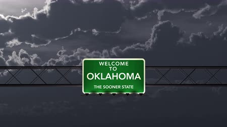 межгосударственный : 4K Passing under Oklahoma USA Interstate Highway Road Sign at Night Photo Realistic 3D Animation with Matte 4K 4096x2304 ultra high definition