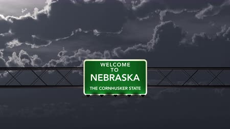 nebraska : 4K Passing under Nebraska USA Interstate Highway Road Sign at Night Photo Realistic 3D Animation with Matte 4K 4096x2304 ultra high definition Stock Footage