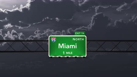 освещенный : 4K Passing under Miami USA Interstate Highway Sign at Night with Matte Photo Realistic 3D Animation
