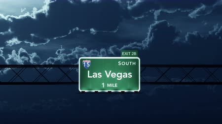 освещенный : 4K Passing under Las Vegas USA Interstate Highway Sign at Night with Matte Photo Realistic 3D Animation