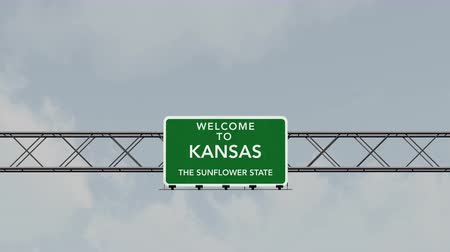 city limits : 4K Passing under Welcome to Kansas State USA Interstate Highway Sign with Matte Photo Realistic 3D Animation