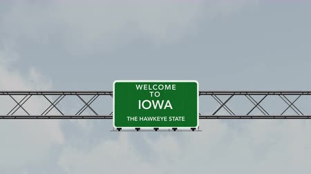 iowa : 4K Passing under Welcome to Iowa State USA Interstate Highway Sign with Matte Photo Realistic 3D Animation Stock Footage