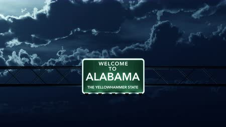 alabama : 4K Passing under Alabama USA Interstate Highway Road Sign at Night Photo Realistic 3D Animation with Matte 4K 4096x2304 ultra high definition