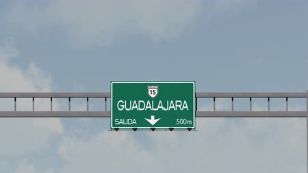 ориентация : 4K Passing Guadalajara Mexico Highway Road Sign with Matte 1 neutral Стоковые видеозаписи