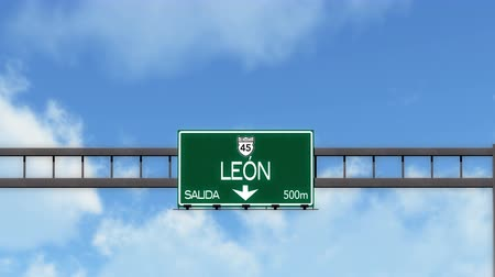 city limits : 4K Passing Leon Mexico Highway Road Sign with Matte 2 stylized Stock Footage
