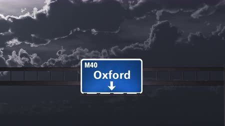 İngilizce : 4K Passing under Oxford United Kingdom Highway Road Sign at Night Photo Realistic 3D Animation with Matte 4K 4096x2304 ultra high definition