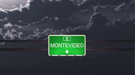 montevideo : 4K Passing under Montevideo Uruguay Highway Road Sign at Night Photo Realistic 3D Animation with Matte 4K 4096x2304 ultra high definition Stock Footage