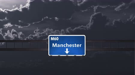 city limits : 4K Passing under Manchester United Kingdom Highway Road Sign at Night Photo Realistic 3D Animation with Matte 4K 4096x2304 ultra high definition