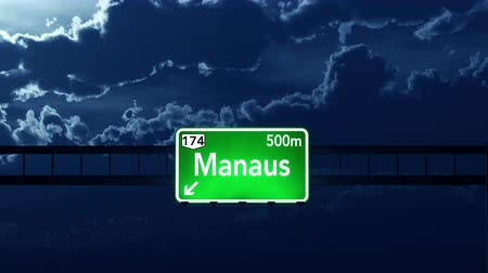 manaus : 4K Passing under Manaus Brazil Highway Road Sign at Night Photo Realistic 3D Animation with Matte 4K 4096x2304 ultra high definition Stock Footage