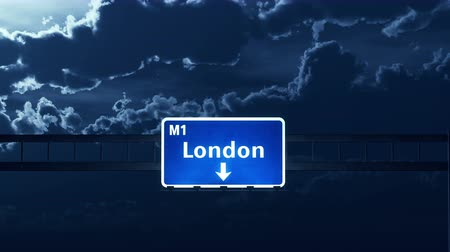 İngilizce : 4K Passing under London United Kingdom Highway Road Sign at Night Photo Realistic 3D Animation with Matte 4K 4096x2304 ultra high definition Stok Video