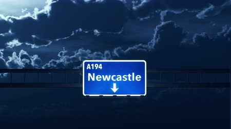 wielka brytania : 4K Passing under Newcastle United Kingdom Highway Road Sign at Night Photo Realistic 3D Animation with Matte 4K 4096x2304 ultra high definition