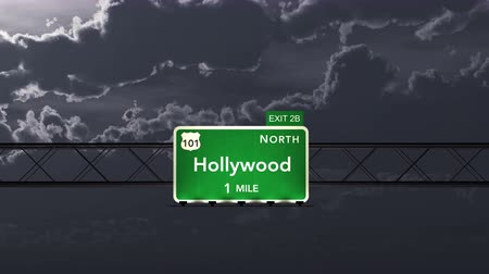 north america : 4K Passing under Hollywood USA Interstate Highway Road Sign at Night Photo Realistic 3D Animation with Matte 4K 4096x2304 ultra high definition