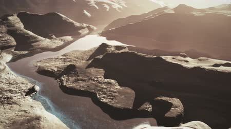 arıza : Aerial Shot of a Rocky Canyon and a Lake 3D Animation 9 stylized Stok Video
