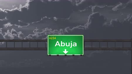 abuja : 4K Passing under Abuja Nigeria Highway Road Sign at Night Photo Realistic 3D Animation with Matte 4K 4096x2304 ultra high definition