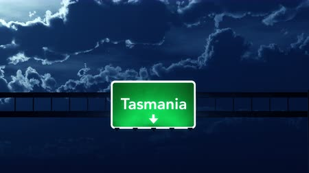 tasmania : 4K Passing under Tasmania Australia Highway Road Sign at Night Photo Realistic 3D Animation with Matte 4K 4096x2304 ultra high definition