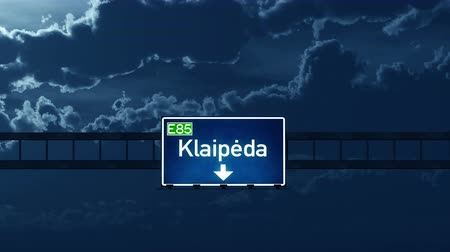 klaipeda : 4K Passing under Klaipeda Lithuania Highway Road Sign at Night Photo Realistic 3D Animation with Matte 4K 4096x2304 ultra high definition