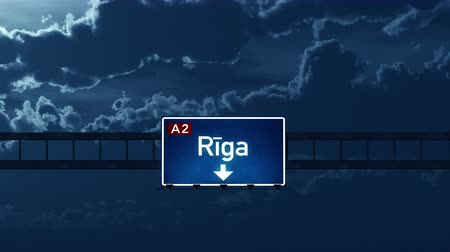 riga : 4K Passing under Riga Latvia Highway Road Sign at Night Photo Realistic 3D Animation with Matte 4K 4096x2304 ultra high definition