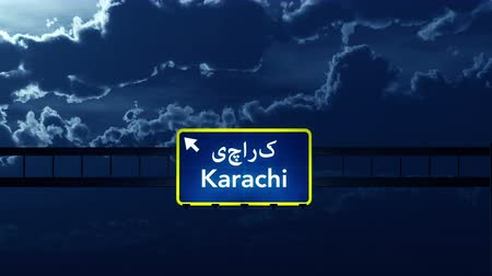 paquistão : 4K Passing under Karachi Pakistan Highway Road Sign at Night Photo Realistic 3D Animation with Matte 4K 4096x2304 ultra high definition Stock Footage