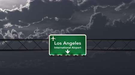 uluslararası : 4K Passing Los Angeles USA Airport Sign at Night with Matte 3 neutral Stok Video