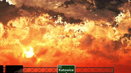 katowice : 4K Passing Katowice Poland Highway Sign in the Sunset Wideo