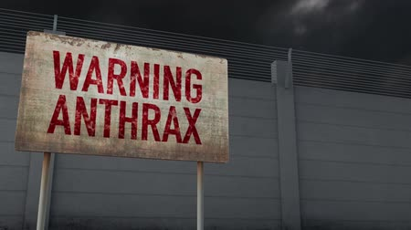 hekje : 4K Anthrax Warning en Strong Fence under Clouds Timelapse Stockvideo