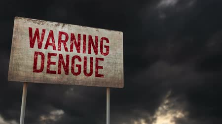 donder : 4K Dengue Warning Rusty Sign under Clouds Timelapse