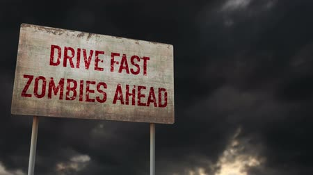 зловещий : 4K Drive Fast Zombies Ahead Rusty Sign under Clouds Timelapse