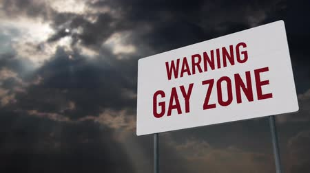 зловещий : 4K Gay Zone Warning Sign under Clouds Timelapse Стоковые видеозаписи