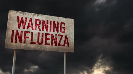 donuk : 4K Influenza Warning Rusty Sign under Clouds Timelapse Stok Video