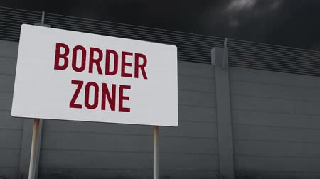 зловещий : 4K Massive Fence and Border Zone Sign under Clouds Timelapse 1 Стоковые видеозаписи