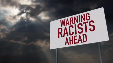 donuk : 4K Racists Ahead Warning Sign under Clouds Timelapse Stok Video