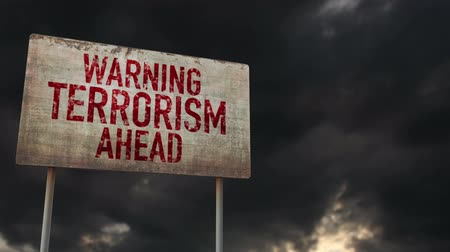 donuk : 4K Terrorism Ahead Warning Rusty Sign under Clouds Timelapse