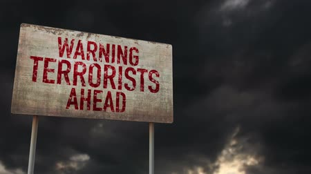 donuk : 4K Terrorists Ahead Warning Rusty Sign under Clouds Timelapse Stok Video