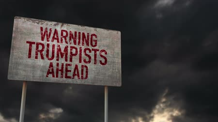 donuk : 4K Trumpists Ahead Warning Rusty Sign under Clouds Timelapse