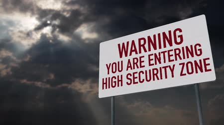 donder : 4K Warning Entering High Security Zone Sign under Clouds Timelapse