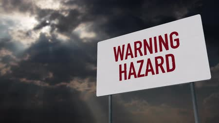 donuk : 4K Warning Hazard Sign under Clouds Timelapse Stok Video