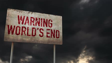 hátborzongató : 4K World End Ahead Warning Rusty Sign under Clouds Timelapse