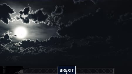 eyaletler arası : 4K Passing Blue BREXIT Sign at Night