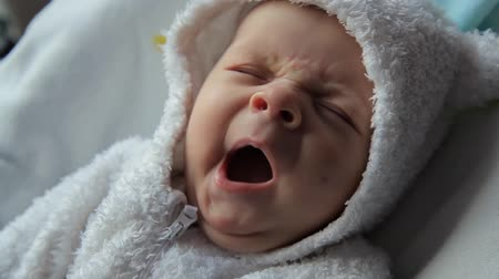 baby wakes up and looks
