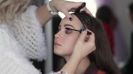 make-up artist working with model