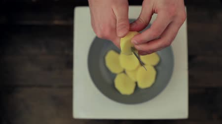 hand cut potatoes with a knife