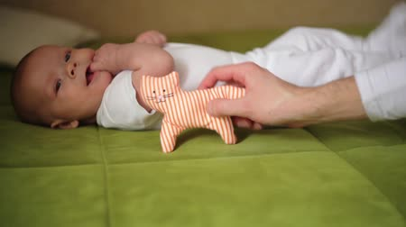 Happy newborn baby yawns closeup in white bed Stok Video