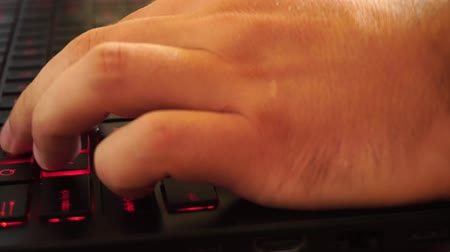 compelling : laptop Keyboard lighting up and hands gaming on it with slider movement