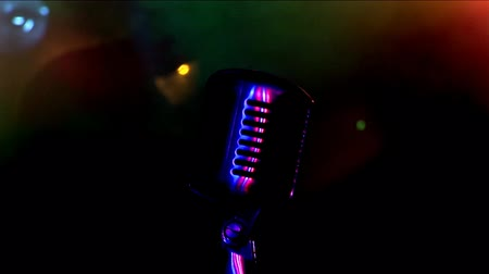 śpiew : Microphone, colour lights, rock Concert.