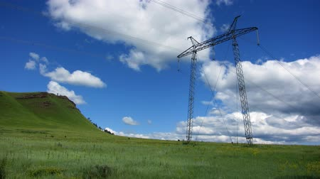kable : Time lapse of running clouds with electricity pylon.