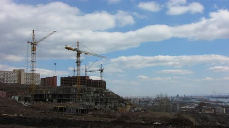 site : Time lapse of cranes on a building sites.