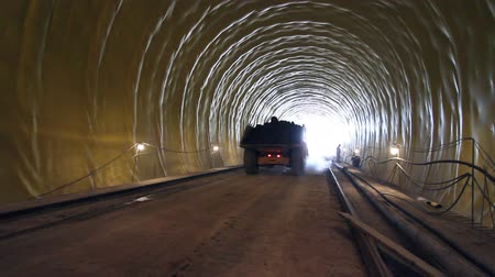 шахта : Car on construction site of highway tunnels.